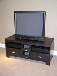 4D Concepts TV Stand w/2DR and 2 CD DRS/Black Woodgrain Laminate